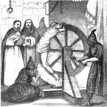 man being tortured on wheel
